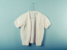 Woolen jumper on wirer hanger Stock Image