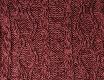 Woolen knitting background. Marsala knitting textures of sweater Royalty Free Stock Photo