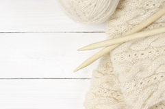 Woolen knitting on wood Royalty Free Stock Photography