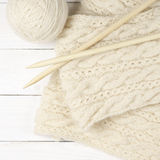 Woolen knitting on wood Stock Photography