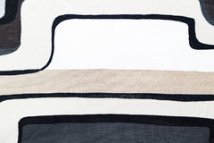 Woolen knitwear fabric with gray geometric pattern Royalty Free Stock Image