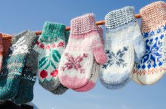 Woolen mittens hanging on a rope. Christmas Market. Stock Photos