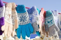 Woolen mittens hanging on a rope. Christmas Market. Royalty Free Stock Images