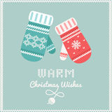 Woolen Mittens with Warm Christmas Wishes SIgn. Christmas Card or Background. Winter Christmas Card or Background with Male and Female Mittens and Warm Christmas Royalty Free Stock Image
