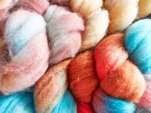 Woolen multi-colored handmade yarn, scythes, macro. Stock Photography