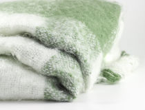 Woolen plaid white and light green on the white background. Woolen plaid white and light green Royalty Free Stock Photos