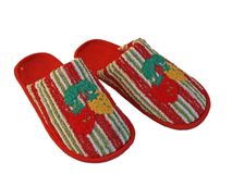 Woolen slippers. Red color woolen slippers, isolated on white Royalty Free Stock Photo
