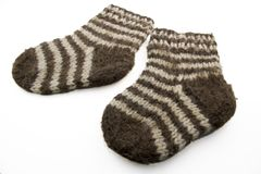 Woolen socks. Child woolen striped socks isolated on white Royalty Free Stock Image