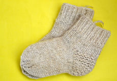 Woolen socks. Socks for the baby of natural goat hair Stock Images