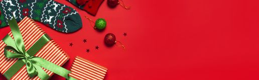 Woolen socks with a Christmas New Year ornament on red background top view flat lay. Holiday concept, Festive socks, presents Xmas. Congratulations background stock photography