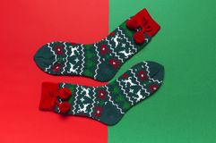 Woolen socks with a Christmas New Year ornament on red background top view flat lay. Holiday concept, Festive socks, presents Xmas. Congratulations background royalty free stock photography