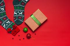 Woolen socks with a Christmas New Year ornament on red background top view flat lay. Holiday concept, Festive socks, presents Xmas. Congratulations background stock photo
