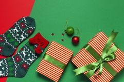 Woolen socks with a Christmas New Year ornament on red background top view flat lay. Holiday concept, Festive socks, presents Xmas. Congratulations background stock photos