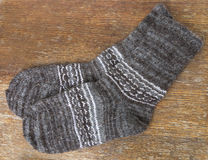Woolen socks. On a wooden Royalty Free Stock Photo