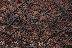 Woolen spun yarns, woolen spun yarns between iron nails, woolen spun yarns between iron nails on a wooden base Royalty Free Stock Image