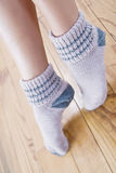 Woolen stockings. Walking home with a pair of socks at the foot of wool stock image