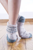 Woolen stockings. Walking home with a pair of socks at the foot of wool stock images