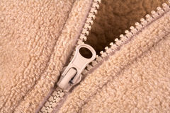 Woolen sweater. Detail of zip in a brown sweater stock photography