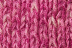 Woolen texture background, knitted wool fabric, pink hairy fluff Stock Images