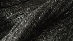 Woolen texture fabric background. Knitted wool pattern texture.