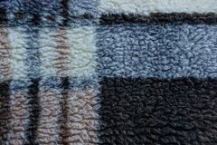 Woolen texture of a gray brown plaid. With a pattern Stock Photography