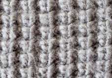 Woolen texture. Macro shot of gray woolen knitted texture royalty free stock photos