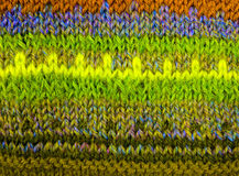Woolen texture from the threads of many colors. Royalty Free Stock Images