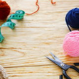 Woolen thread and scissors Royalty Free Stock Photography