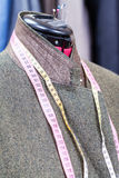 Woolen tweed jacket on dummy and ready suits Stock Photos