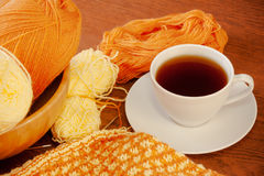 Woolen yarn, knitting and cup of tea Royalty Free Stock Images