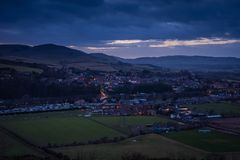 Wooler Town in Twilight. Wooler is a small market town in Northumberland, England and lies at the edge of Northumberland National Park in the foothills of the Stock Images
