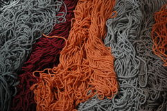Woollean. In colors - gray, red and orange Stock Images