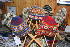 Woollen hats at craft fair Stock Images