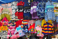 Woollen jumpers on market stall Stock Photography