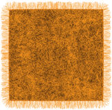 Woollen orange blanket with fringe Stock Photo