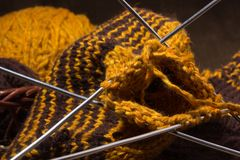 Woollen scarf with  knitting needles. Stock Images