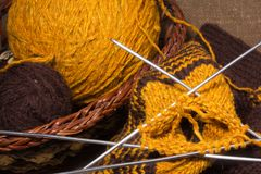 Woollen scarf with  knitting needles. Royalty Free Stock Photography