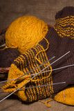 Woollen scarf with  knitting needles. Royalty Free Stock Image