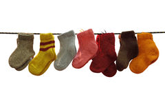 Woollen socks. Seven pairs children's woollen socks on a cord Royalty Free Stock Photography