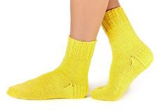Woollen socks. Woman legs in woollen socks on  white background Stock Image