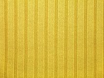 Woollen texture. Yellow woollen texture close-up Stock Images