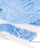 Woollen thread and knitting needle. Stock Photo