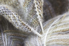 Woollen thread and knitting needle. Royalty Free Stock Photography