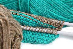 Woollen thread and knitting needle. Royalty Free Stock Photos