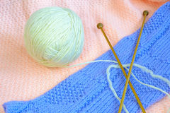Woollens clew with knitting clothes Stock Images