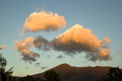 Woolly clouds floating on top of Iguaque mountain royalty free stock photography