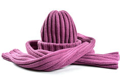 Woolly Hat and Scarf. Purple Woolly Hat and Scarf on a White Background Royalty Free Stock Image