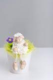 Woolly peluches e flor e grama Imagens de Stock