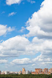 Woolpack clouds over urban district. In summer day Stock Image