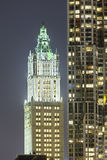 Woolworth Building in New York At Night. The old Woolworth Building next to other skyscrapers in New York at night Stock Images
